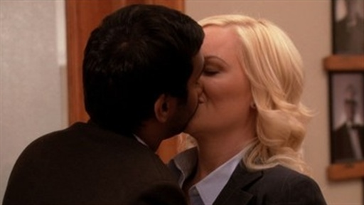 [Leslie and Tom Kiss]