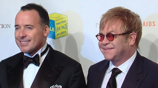 Elton John & David Furnish's 'Enduring' Fight Against AIDS Video