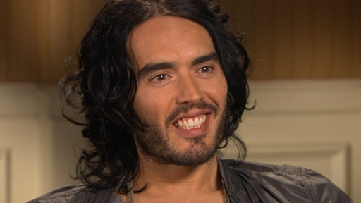 Russell Brand Shows His Funny Side While Talking 'The Tempest' Video