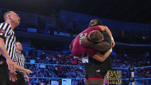 [Mark Henry Drags Daniel Bryan to the Ring and Pummels Him]