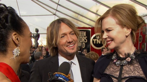 [Keith Urban & Nicole Kidman Have Their 'Hands Full' with Baby Fa]